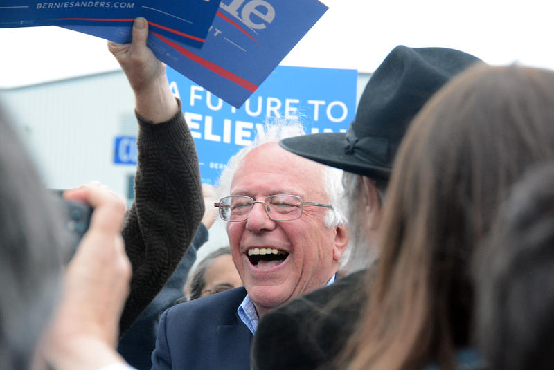 Sen. Bernie Sanders landed in Burlington Wednesday to be greeted by a crowd of more than 150 supporters. Sanders has vowed to fight on for the Democratic nomination, at least for now, and many of his home-state supporters stand behind that decision.
