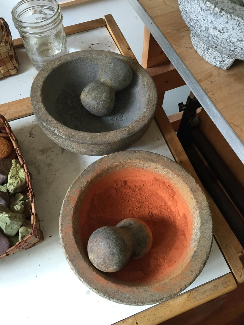One of Neddo's first steps is to smash the rocks and grind them with a mortar and pestle.