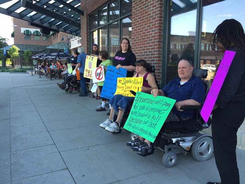"About a dozen Vermonters lined up outside the Majestic 10 movie theater in Williston on Friday, June 3 to call attention to what they say is a problematic depiction of disability in the film ""Me Before You."""