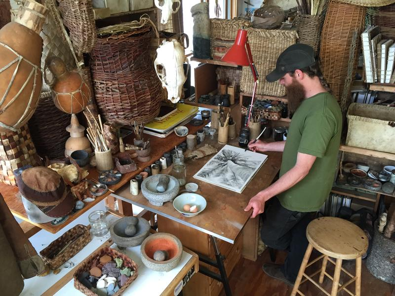 "Nick Neddo, pictured here in his Montpelier studio, is a wildcrafting artist. For this ""Summer School"" lesson, he explains how to make paint pigment from rocks."