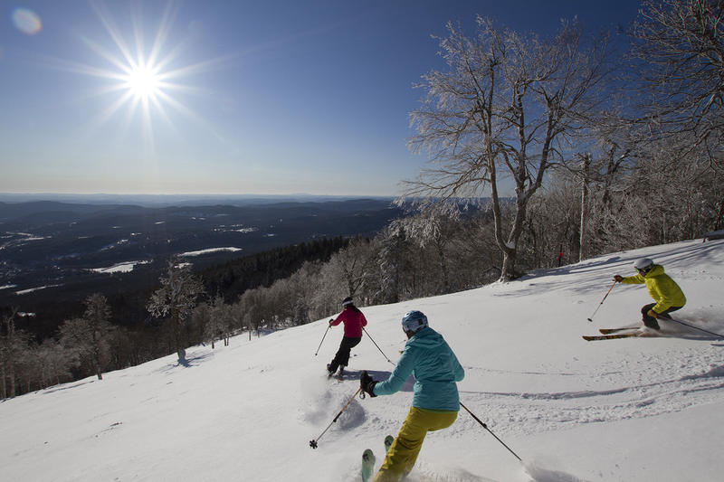 Skiers on a sunny day at Okemo Mountain Resort.