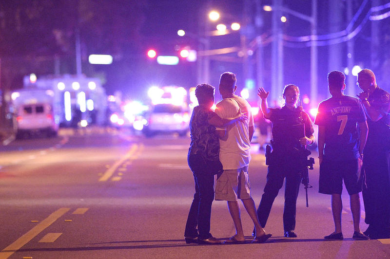 Orlando Police officers direct family members away from a fatal shooting at Pulse Orlando nightclub in Orlando on Sunday, June 12. A vigil will be held in Burlington Monday in response to the shooting, the deadliest in U.S. history.