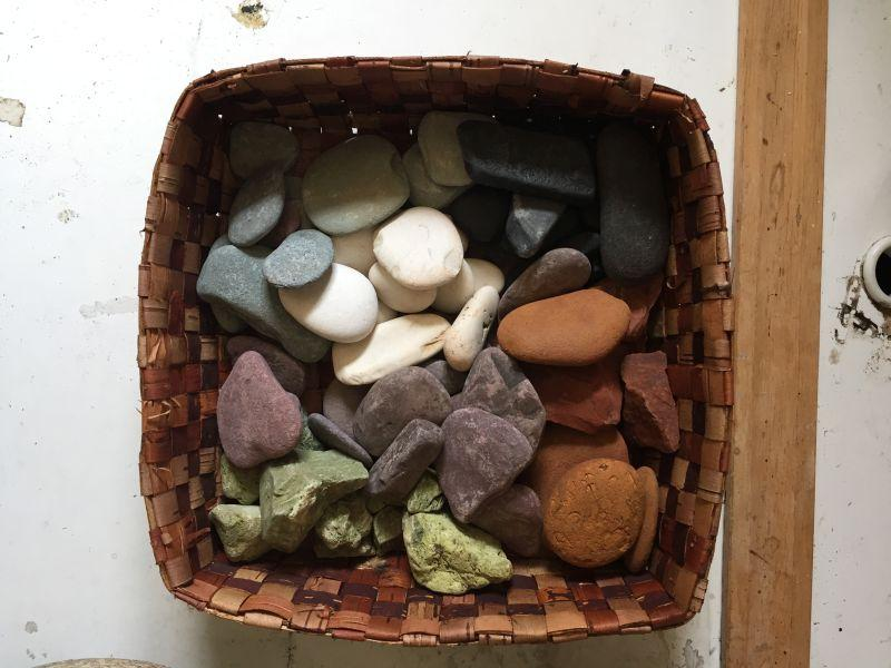 The first step to making paint is to find rocks of unusual colors.