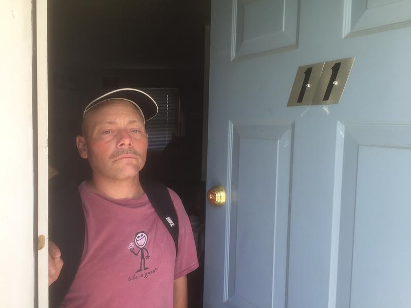 Mitch Butler stands at his door at Beacon Apartments, a long-term housing project in South Burlington.