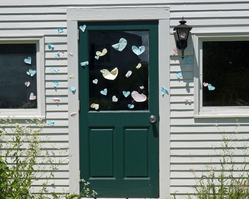 Members of the college community responded to the egging by papering the targeted doors with cut-out hearts.