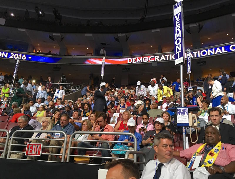 "As festivities got underway Monday, the Vermont delegation settled into their area on the the first few rows of raised seating in the Wells Fargo Center, referred to as ""The Floor."""