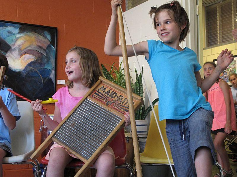 Young musicians play in a jam session during Trad Camp at Summit School of Traditional Music and Culture in Montpelier. Dana Robinson, the camp's executive director, says the mission of the school comes from the simple act of playing music together.