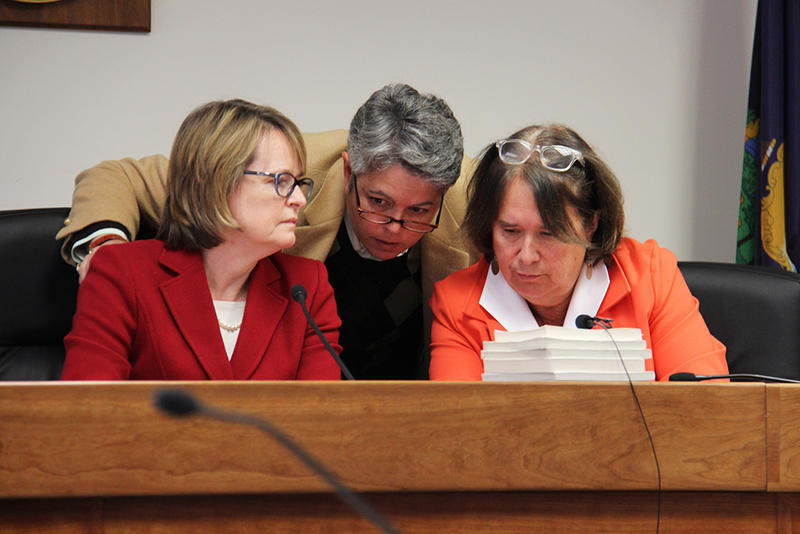 Public Service Board members Margaret Cheney, left, and Sarah Hofman, right, conferred with staff at a board hearing in 2015.