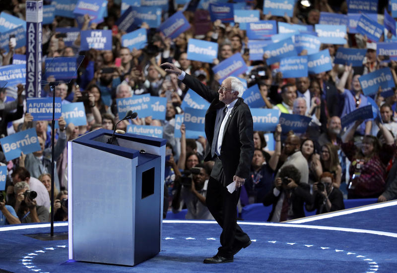 "On opening night of the Democratic National Convention Monday, Sen. Bernie Sanders walked on to the Wells Fargo Center stage to thunderous cheers and applause from attendees with ""Bernie"" signs held high."
