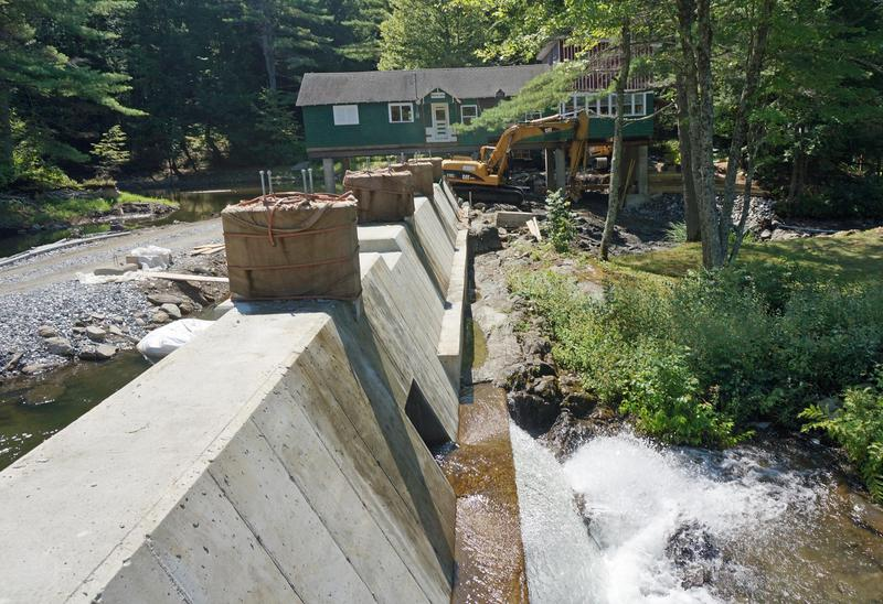 This new dam on Lake Fairlee is a cooperative project of the towns of Fairlee, Thetford and West Fairlee. The owner of the camp in the background deeded the old failing dam over to the three towns to rebuild and maintain.