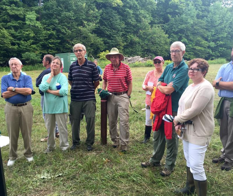 A group of residents and Dartmouth representatives listen to a presentation about the re-excavation of the Rennie Farm burial site, which has contaminated ground water and affected the drinking water at one private residence.
