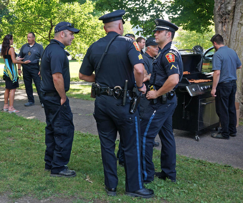 Police officers in St. Albans mingle with during National Night Out on Tuesday, August 2. A handful of Vermont police departments celebrated the nationwide event, including Fair Haven, Milton, Rutland, St. Albans and Swanton.