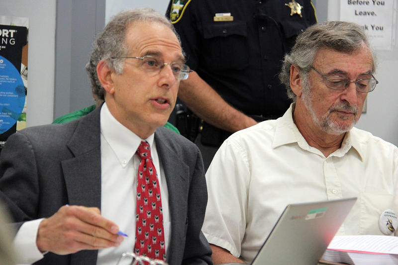 Jim Dumont, a lawyer for Hinesburg residents, cross-examines Vermont Gas at a Public Service Board hearing Thursday morning. Bill Marks, one of the residents, is at right.