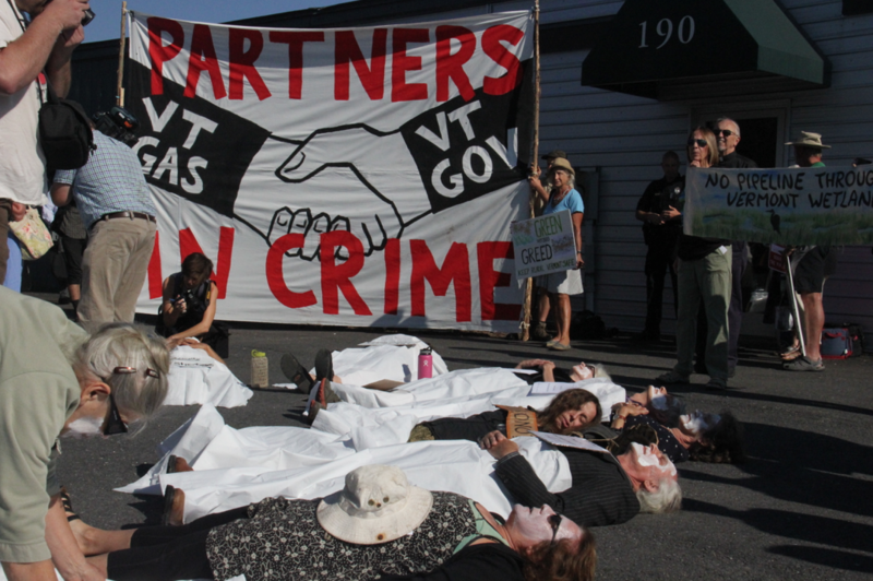 """Thursday morning, dozens of protestors held a """"die-in"""" outside of the hearing location in Berlin."""