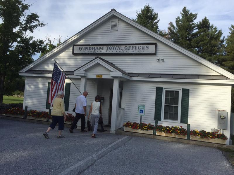 Windham residents enter the town offices prior to Monday night's Selectboard meeting. The board finalized the wording for vote set for Nov. 8.