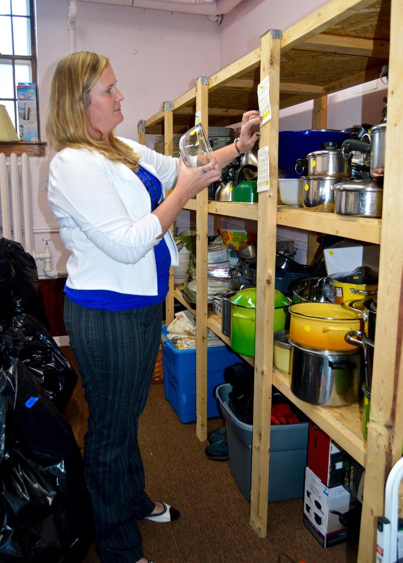 Barb Richter explains how Rutland Welcomes has organized donated pots, pans, plates and glasswear for Syrian refugees they hope will come to Rutland.