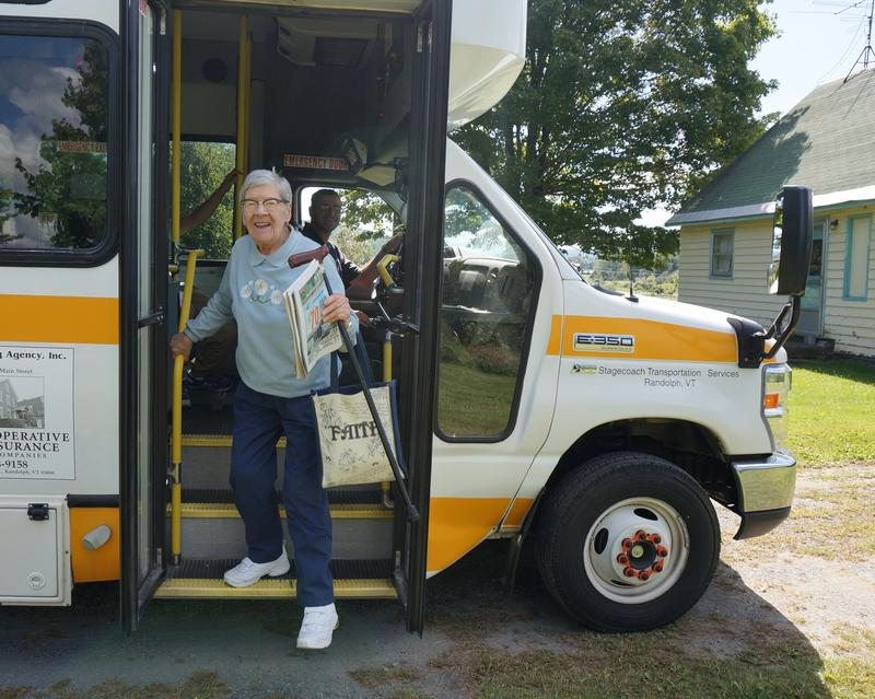 Randolph Town resident Barbara Brown disembarks from a Stagecoach bus after receiving door-to-door service between the local senior center and her home.