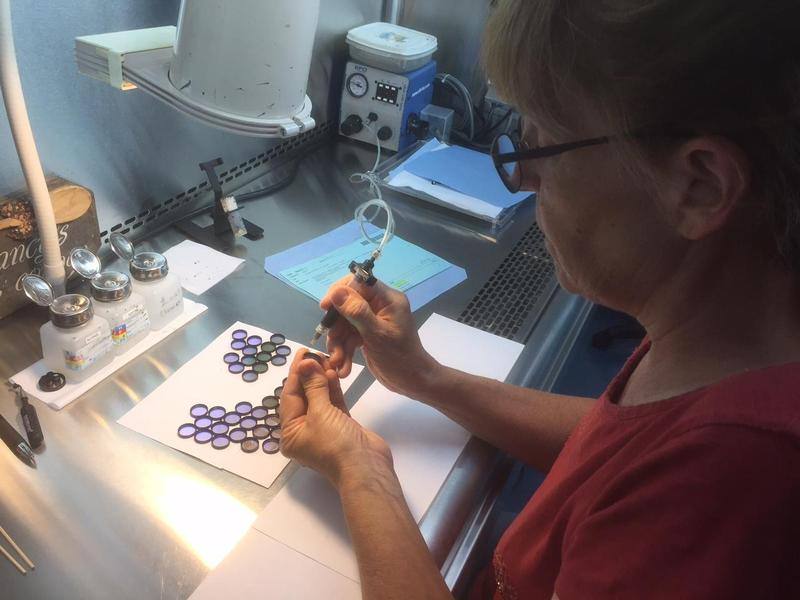Nancy Harrington applies epoxy to filters to attach them to aluminum rings. Harrington is one of the 106 worker-owners at Chroma Technology in Rockingham, which will be expanding in a $19 million deal that could eventually add 26 well-paying jobs.