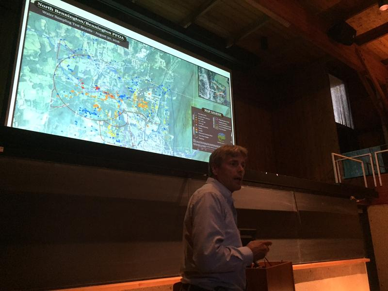 Department of Environmental Conservation Waste Management Director Chuck Schwer talks at a meeting in Bennington. The map behind him shows the properties contaminated with PFOA.