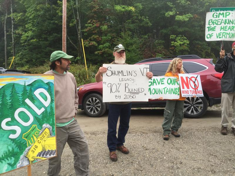 Protesters line the road on the way up to a groundbreaking ceremony for the Deerfield Wind project Monday. The 30-megawatt project in the Green Mountain National Forest is expected to be online by the end of 2017.