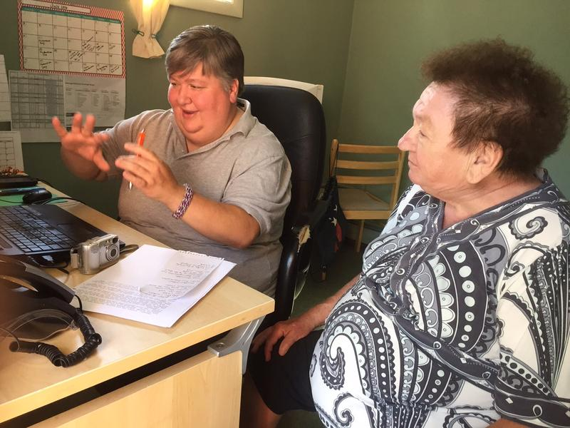Neil Allen, left, editor of The Message for the Week, a weekly paper out of Chester, talks with writer Ruthie Douglas. Allen, who is transitioning, recently covered a debate in Chester about bathroom use for transgender students.