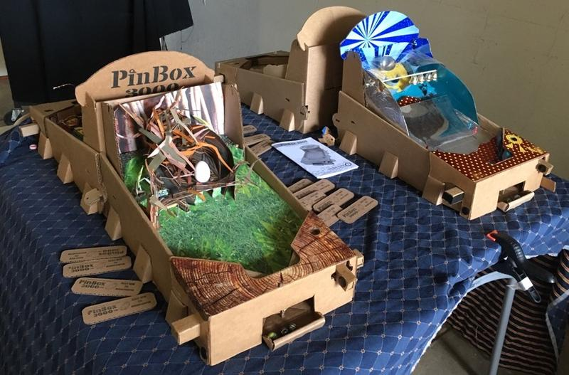 "Examples of the ""PinBox 3000"" were on display at the South End Art Hop in Burlington, pictured here on Sept. 10. The founders of the Cardboard Teck Instantute join ""Vermont Edition"" to talk more about the PinBox 3000."