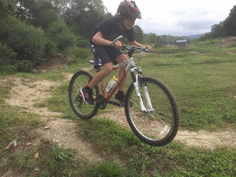 Miles Plitt, 11, rides a bike at Putney Central School. The school invested in mountain bikes and built a pumptrack. The principal says high stakes tests should not drive decision making in Vermont schools.