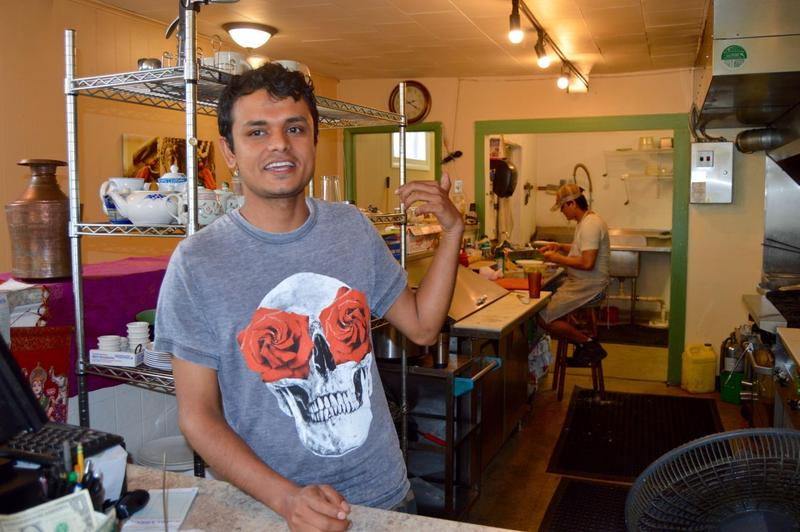 Sudershan Adhikari, a Nepalese refugee has lived in Vermont since 2012. He opened The Spice Trader's Kitchen restaurant in Winooski less than three years later and now employs five people including Bhakta Pradhan at work behind him.