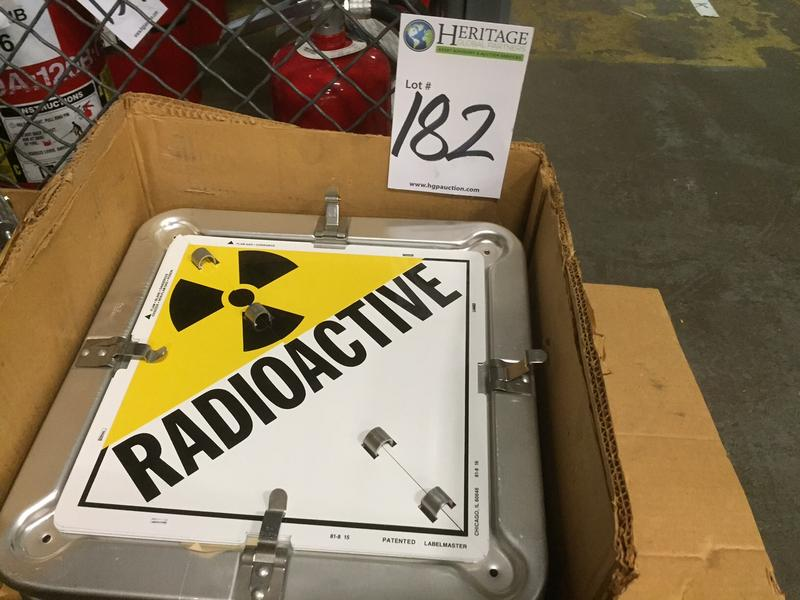 "A box of ""radioactive"" signs, marked as item ""182"", are for sale in the Vermont Yankee public auction."