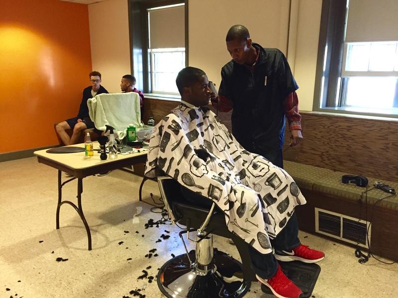 A Dartmouth student gets his monthly haircut from Sean Taylor in the basement of a Dartmouth dorm. The college has contracted Taylor, who is from Philadelphia, to provide his services for students who have limited options in the Upper Valley.