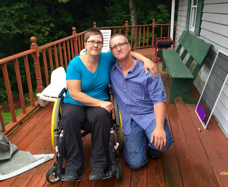 Debbie and Richard Higgins sit on the deck of their customized house. Their land has been contaminated by a Dartmouth College hazardous waste site. The school has three months to relocate the couple to a new permanent home or face a lawsuit.