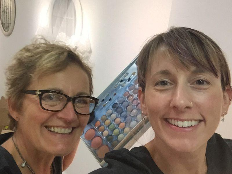 Artists Mary Admasian and Kristen M. Watson pose for a selfie among their installation art work for the SHE Project, Part 1