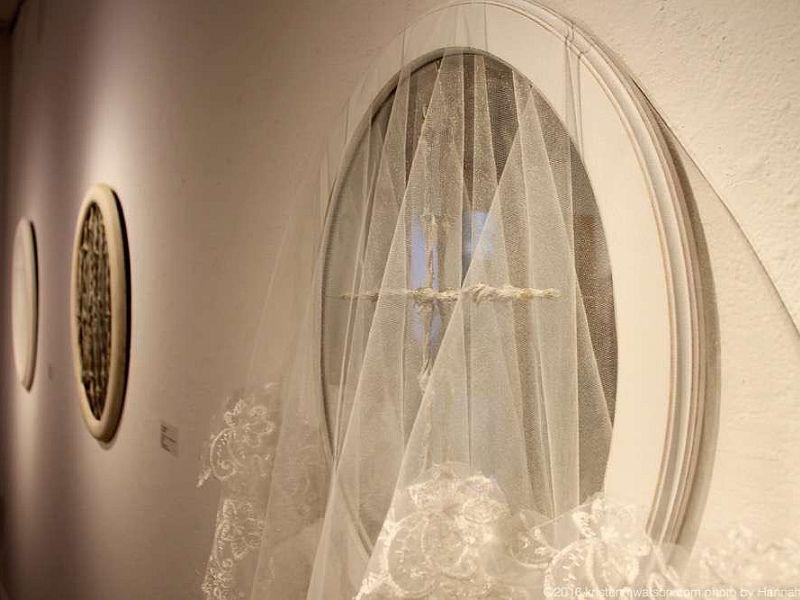 Titled, 'Blessed' this mirror with barbed wire, silk, gold wire and a wedding veil is part of 'The SHE Project, Part 1' and created by Mary Admasian.