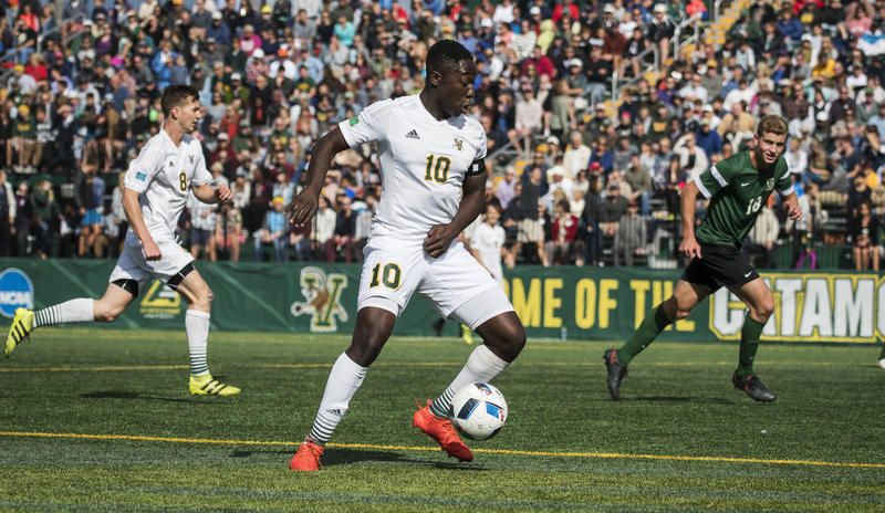 University of Vermont men's soccer player Bernard Yeboah in a game against Dartmouth. Yeboah and teammate Brian Wright are close to breaking UVM's records for the most goals and total points by teammates in a single season.