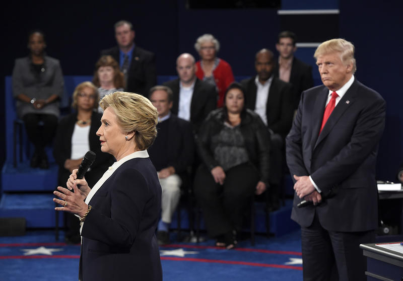 Democratic presidential nominee Hillary Clinton, left, speaks as Republican presidential nominee Donald Trump watches during the second presidential debate at Washington University in St. Louis on Sunday.