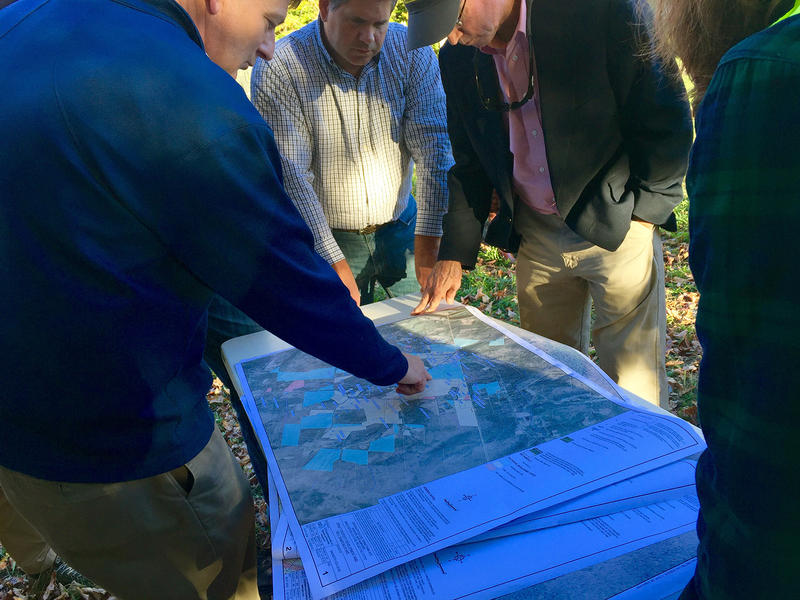 At a community meeting Tuesday night, Dartmouth contractor Jim Wieck shows neighbors a map of wells being tested for the chemical 1-4, dioxane, and the nearly 1-mile distance between the Rennie Farm burial site and a third contaminated property.