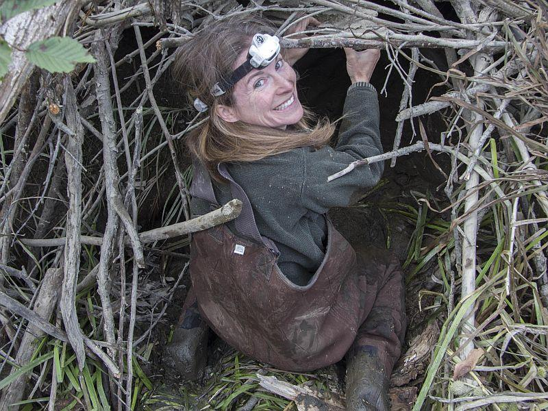 Biologist Sara Zahendra of the Vermont Center for Ecostudies prepares to enter a beaver dam.