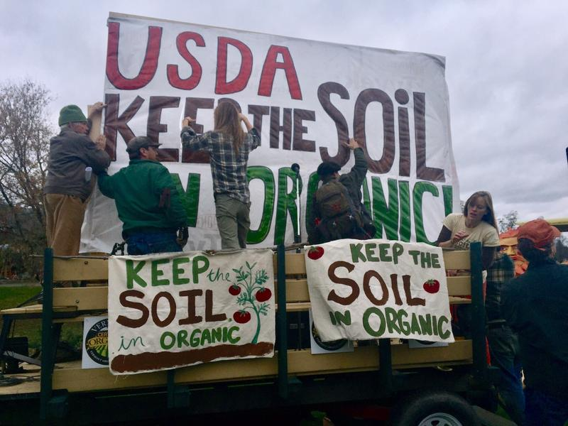 "At a rally in Thetford in November, lawmakers and advocates protest the potential inclusion of hydroponically-grown food among foods that can be labeled ""organic."""