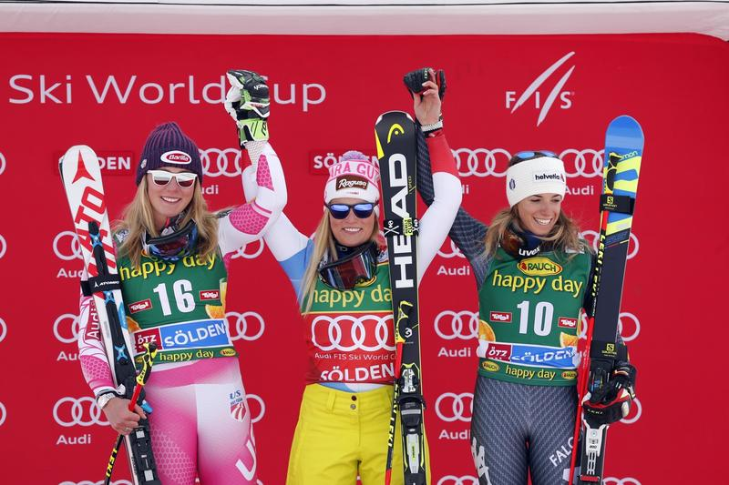 Lara Gut, center, celebrates winning the giant slalom at the season's first World Cup race in Soelden, Austria, in October. Mikaela Shiffren, left, placed second while Marta Bassino placed third. The women will race at Killington Nov. 26 and 27.
