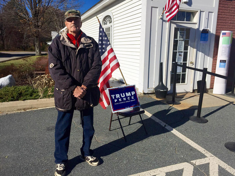 Amsden resident Bill Bushaw, who says he was previously a longtime Democrat, stand with a sign supporting Donald Trump at outside the Weathersfield Town Office.