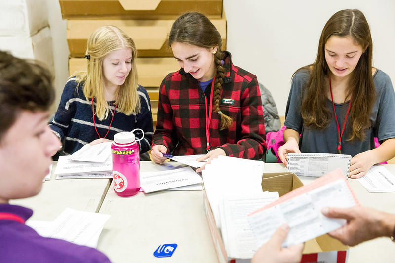 CVU students from an AP U.S. Government and Politics class sort through absentee ballots at the Shelburne Town Center Gymnasium on Tuesday morning.