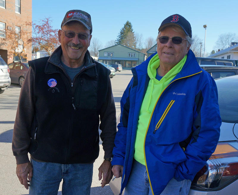 Brothers-in-law Ed Lambert, left, and Val Gorham, both of Morrisville, met up to chat in the parking lot after voting.