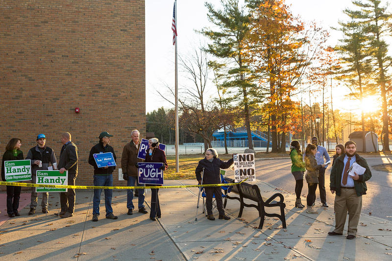 Electioneers campaign outside of the Frederick H. Tuttle Middle School polling location in South Burlington on Tuesday morning.