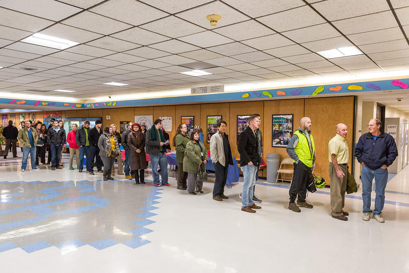 South Burlington voters wait in line at the Frederick H. Tuttle Middle School in South Burlington on Tuesday morning.