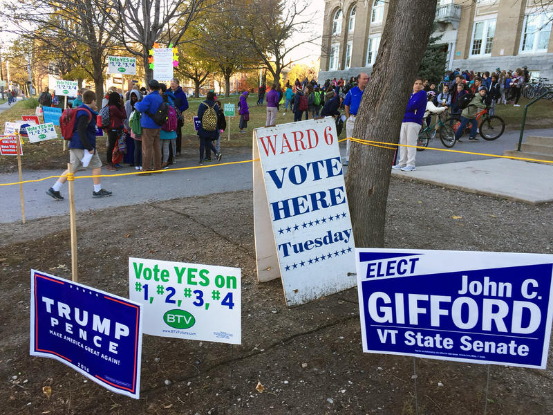 Signs and voters outside the Ward 6 polling place at Edmunds Middle School in Burlington.