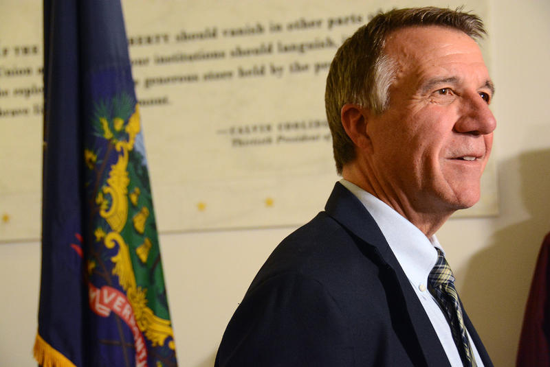 Profile of Governor Phil Scott with Vermont flag in background.
