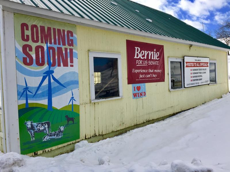 Holland resident, Phil Laterno, adorns one of his sheds with a poster announcing that wind turbines are coming soon to the area. A proposed wind turbine has caused contention in the small town in the Northeast Kingdom.