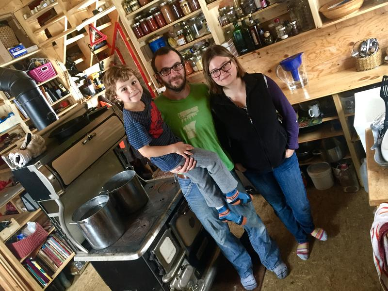 Ben Servoz and Nicole Antal with their son Robin, 6, inside their tiny house in Sharon. This is the second winter that the family has lived off the grid.