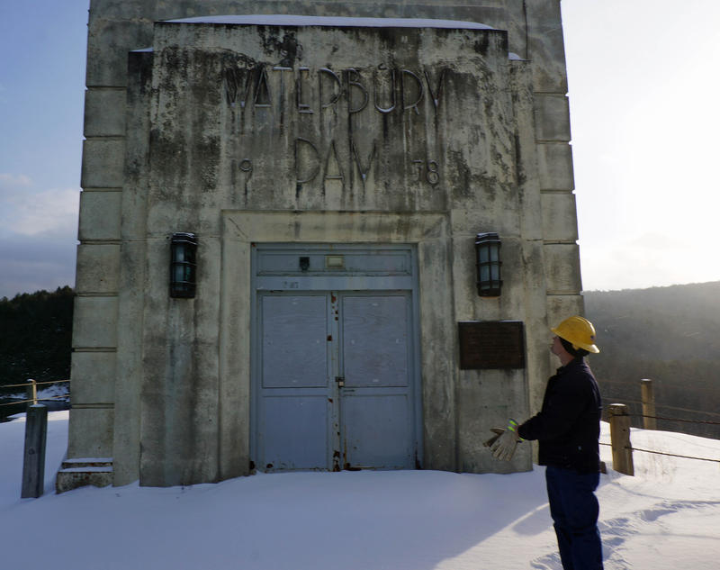 Green Mountain Power's Richard Boisvert stands atop the Waterbury Dam, which was constructed between 1935 and 1938. The dam might benefit from new fedearl legislation that would fund repairs for certain historic dams.