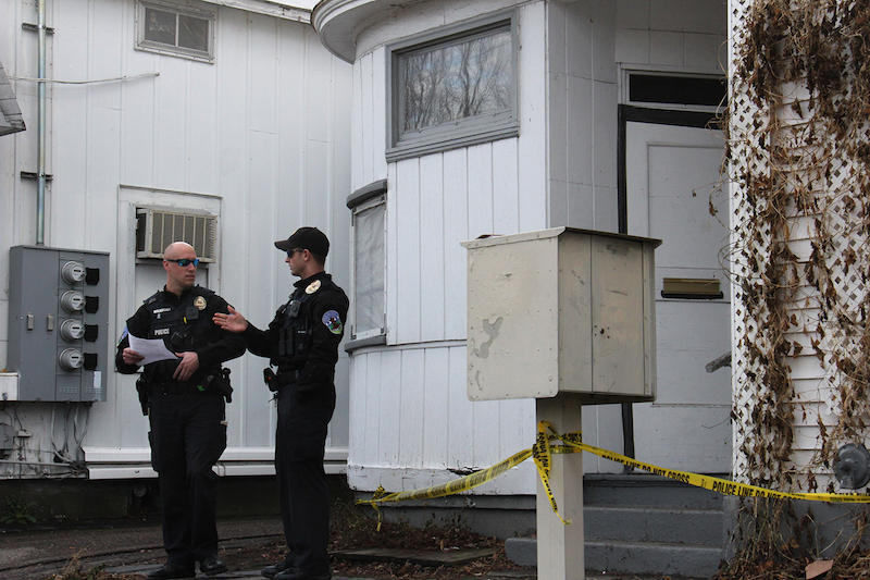 Police officers are shown on Dec. 22, 2016 after DEA agents fatally shot a man following a raid. The shooting was caught on body camera footage. Vermont is working on with new rules to govern the use of the technology.